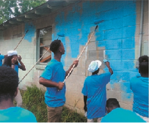 MCTS Students Painting Home